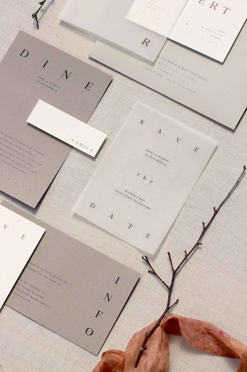 a minimalist shades of grey wedding invitation suite with sheer parts and black letters is a lovely idea for a minimal wedding in greys