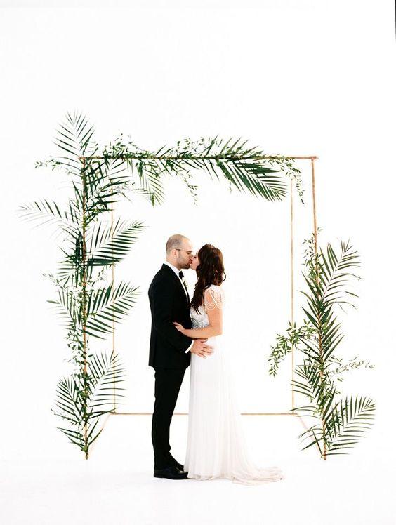 a minimalist tropical wedding arch design