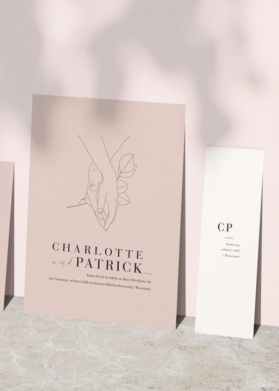 a minimalist wedding invitation suite in tan and white, with black lettering and a touching print is a lovely idea