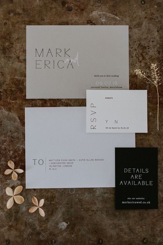 a minimalist wedding invitation suite in white, light grey and black, with modern lettering and a bit of calligraphy shows off the color schene