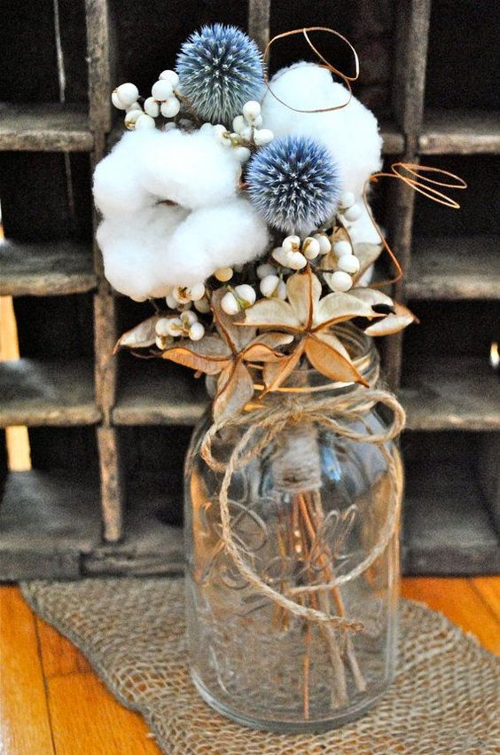 a rustic wedding centerpiece of berries, allium, cotton and dried touches is a lovely and very beautiful decor idea for any wedding