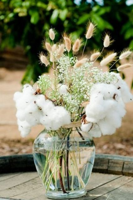 a rustic wedding centerpiece of bunny tails, baby's breath and cotton is always a good idea for both rustic and boho wedding
