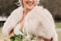 a simple and lovely winter wedding bouquet of white blooms, greenery, evergreens, thistles, pinecones is a beautiful and textural solution for winter