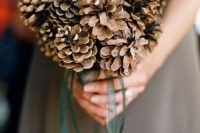 a simple only pinecone wedding bouquet with green ribbons is a lovely idea for both a fall or a winter wedding and it will save your budget