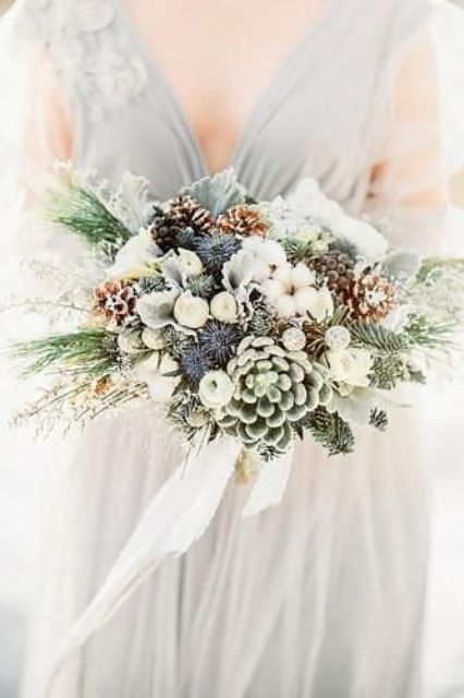 a stunning neutral winter wedding bouquet of white blooms, cotton, succulents, thistles, snowy pinecones and greenery is a gorgeous idea