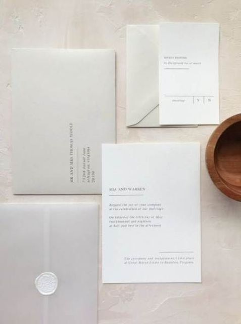 a subtle minimalist wedding invitation suite done in undertones, with stylish calligraphy and lettering and white stamps is cool