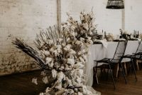 a super lush cottont able runner with tulle and fronds is a good idea for a rustic or boho wedding, can be rocked in any season and looks spectacular
