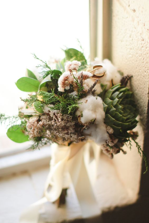 a textural wedding bouquet of cotton, succulents, greenery, dried blooms, ferns is a very pretty and cool idea for the fall