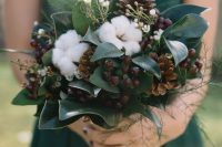 a woodland wedding bouquet of pinecones, cotton, berries, foliage is a lovely idea for both a fall or winter wedding