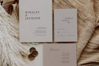 an elegant neutral-colored minimalist wedding invitation suite in light grey and dusty pink, with black lettering is a cool idea