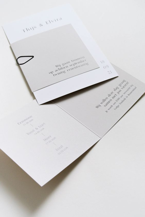 an elegant white and light grey minimalist wedding stationery suite with black letters and black yarn is a cool idea for your minimal wedding