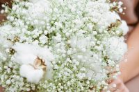 an ethereal winter wedding bouquet of baby's breath and cotton is great for a rustic wedding