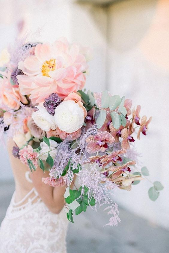 an iridescent wedding bouquet of lilac, blush, coral and white blooms is a gorgeous solution to rock