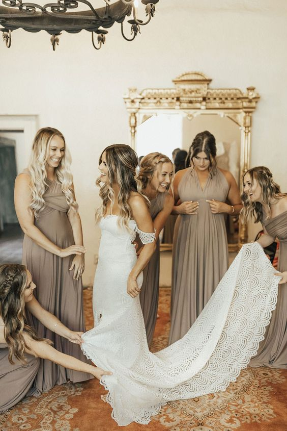 beautiful greige maxi bridesmaid dresses with draped bodices and pleated skirts are lovely for a spring, summer or fall wedding
