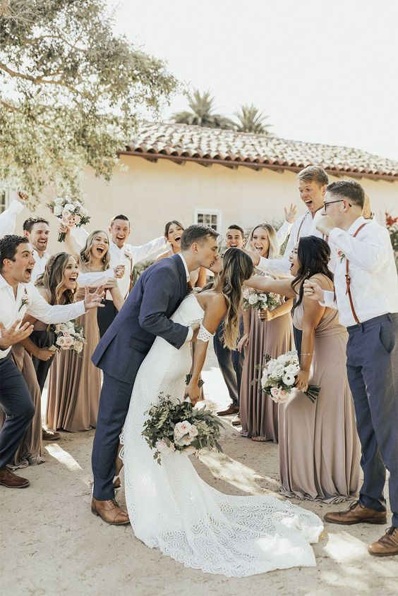 bridesmaids wearing greige maxi bridesmaid dresses with criss cross backs and draped bodices are cool and chic