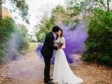 a wedding portrait in the garden accented with a purple smoke bomb is very bold and cool