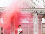 a carved wooden arch accented with a bright pink smoke bomb looks out of this world and fantastic