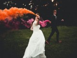 accent your couple walking with bright smoke bombs – this is a very bold and catchy idea