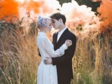 a beautiful wedding portrait in the forest with orange smoke bombs looks bold and very eye-catchy