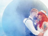 a smoke bomb makes the couple's kiss look ethereal and very accented