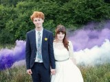 a wedding portrait in the greenery accented with a white and purple smoke bomb looks eye-catchy