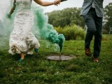 a green smoke bomb echoes with the wedding shoes and adds eye-catchiness to the backdrop