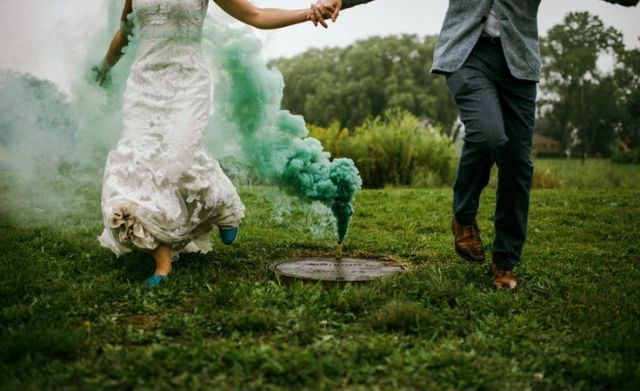 a green smoke bomb echoes with the wedding shoes and adds eye catchiness to the backdrop