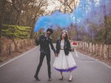 a fun wedding portrait on the road, with a blue smoke bomb that adds a badass feel to the couple
