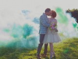 green smoke bombs as a bold and catchy wedding backdrop for a first married iss