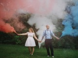 a pretty wedding portrait made more special with colorful smoke bombs looks amazing and fun