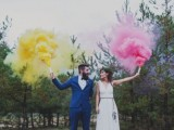 a wedding portrait done in the forest, with bright yellow and pink smoke bombs is a fun and cool idea
