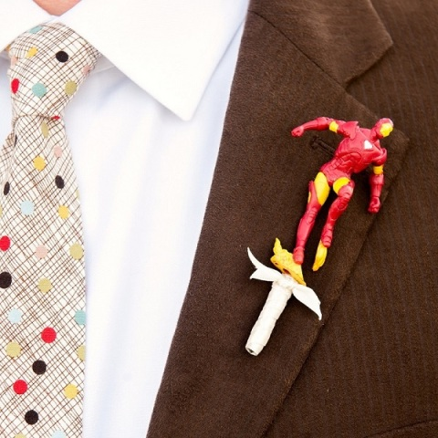 a bright superhero wedding boutonniere - an Iron Man is a playful and cool piece to rock