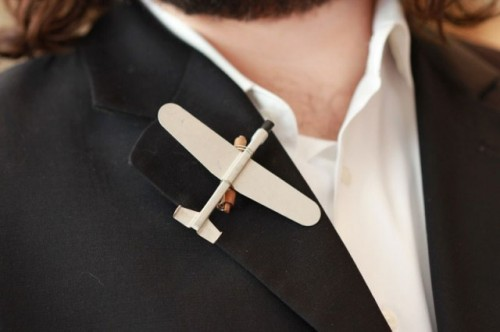 a mini airplane boutonniere for a plane-loving or pilot groom is stylish and cute