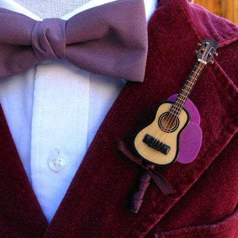 a mini guitar boutonniere is a lovely boutonniere for a music fan or a music-loving wedding