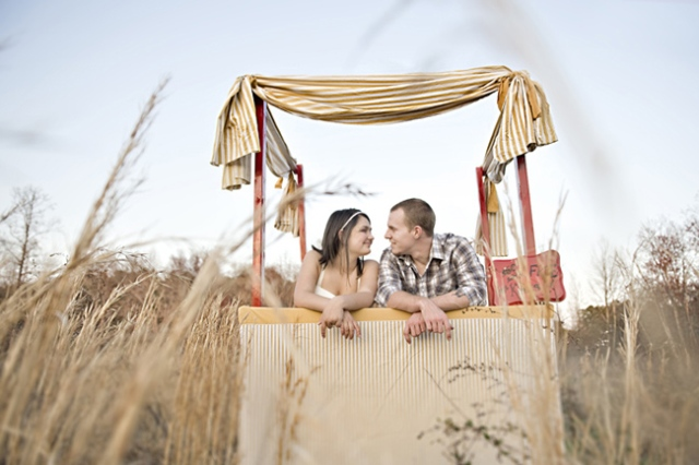 a simple and neutral wedding kissing booth with neutral striped fabric for decor is great for a casual wedding