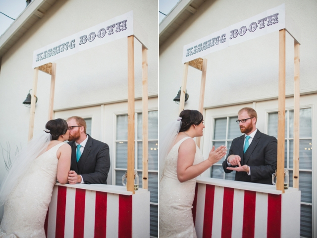 a simple and bright kissing booth with stripes and a sign on top is a cool idea for a modern wedding