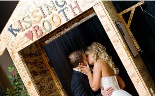 a plywood kissing booth with colorful letters is all you need for fun