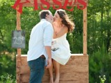 a simple plywood kissing booth with red letters and a chalkboard sign for a cool and cute space