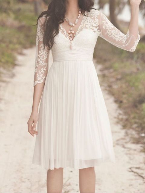 a beautiful vintage wedding dress with a lace bodice with illusion sleeves and a pleated skirt is a lovely idea to rock