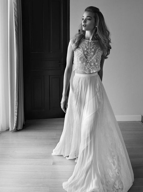a fabulous two-piece wedding dress with a lace sleeveless crop top and a pleated maxi skirt with lace