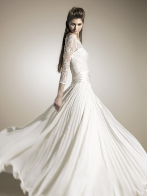 a gorgeous wedding dress with a lace bodice with long sleeves and a high neckline plus a pleated maxi skirt is very chic