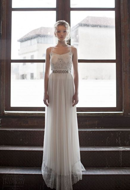 a lovely fitting maxi wedding dress with an embroidered bodice and spaghetti straps plus a pleated skirt with a belt
