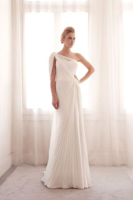 a one shoulder pleated wedding dress with lace detailing is a bold take on traditional Grecian wedding dresses