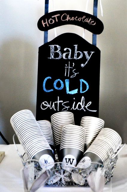 a small hot chocolate station with a chalkboard sign and some cups plus all the rest next to it will save some space