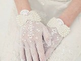 white crocheted gloves with pearl bows are a refined and elegant accessory for a vintage bride