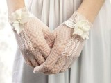white crochet gloves with white fabric flowers and pearls for a romantic and beautiful bridal look