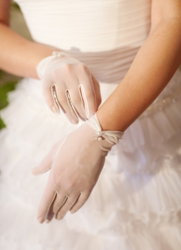 sheer gloves accented with pearls are very chic and romantic and will add an elegant touch to the look