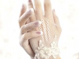 white crochet gloves with crocheted flowers are a delicate and chic accessory for a vintage bride