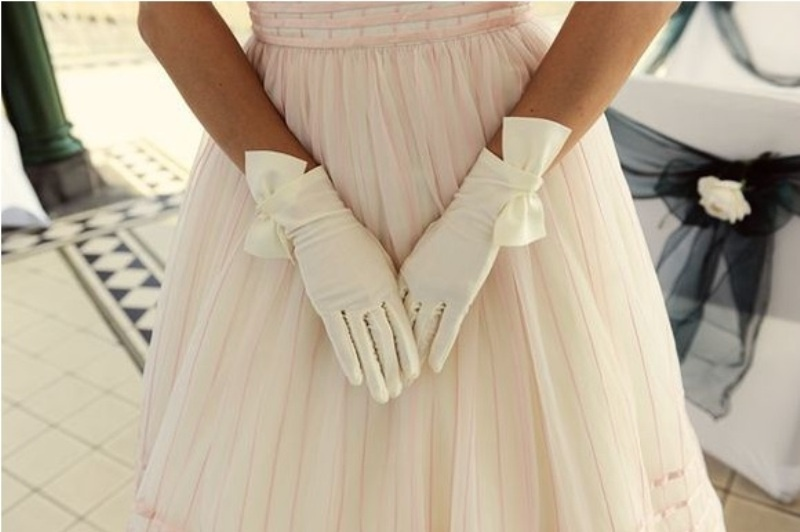 white draped gloves with large bows will add a retro touch to the look and more chic