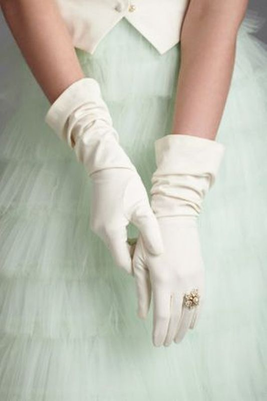 long white plain gloves with a vintage pearl engagement ring right on the glove look wow